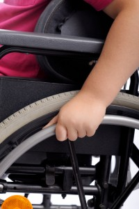 close-up on hand of handicapped child in wheelchair